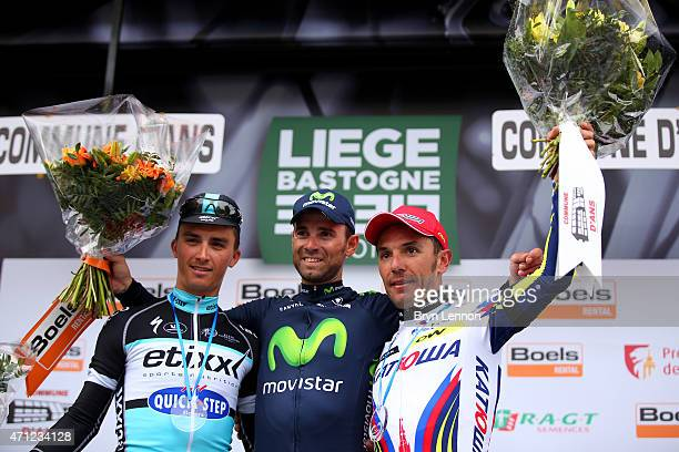 Race winner Alejandro Valverde of Spain and Movistar Team celebrates his victory with second placed Julian Alaphilippe of France and Etixx Quick Step...