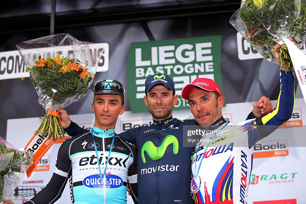 Race winner <a gi-track='captionPersonalityLinkClicked' href=/galleries/search?phrase=Alejandro+Valverde&family=editorial&specificpeople=193419 ng-click='$event.stopPropagation()'>Alejandro Valverde</a> (C) of Spain and Movistar Team celebrates his victory with second placed <a gi-track='captionPersonalityLinkClicked' href=/galleries/search?phrase=Julian+Alaphilippe&family=editorial&specificpeople=6715631 ng-click='$event.stopPropagation()'>Julian Alaphilippe</a> (L) of France and Etixx - Quick Step and third placed Joaquin Rodriguez (R) of Spain and Team Katusha following the 101st Liege-Bastogne-Liege cycle road race on April 26, 2015 in Liege, Belgium.