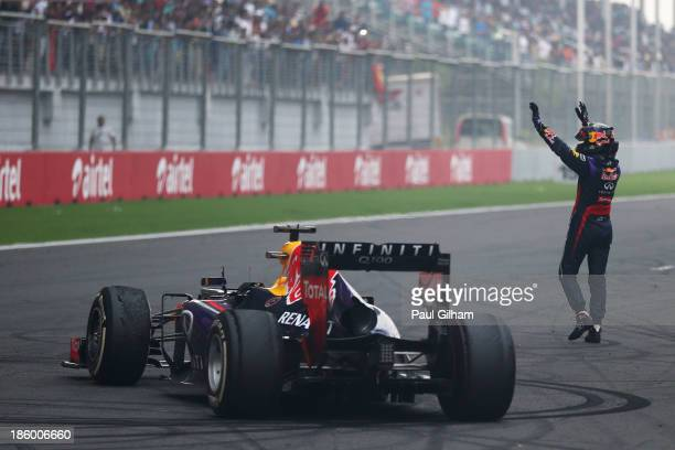 Race winner and 2013 Formula One World Champion Sebastian Vettel of Germany and Infiniti Red Bull Racing celebrates in front of the crowd on the main...