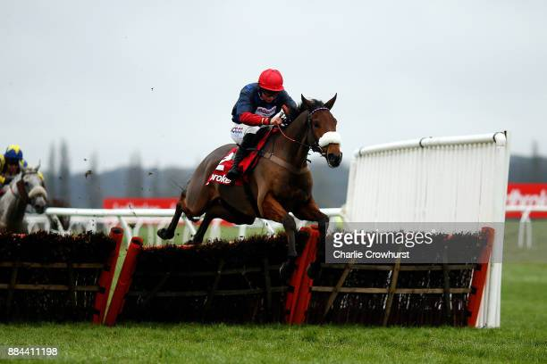 Race winner Bryony Frost jumps the last on Old Guard during The Ladbrokes Handicap Hurdle Race at Newbury Racecourse on December 2 2017 in Newbury...
