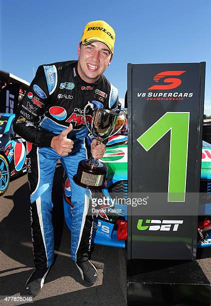 Race winner Chaz Mostert driver of the Pepsi Max Crew PRA Ford FG X Falcon holds the winning trophy after Race 13 for the V8 Supercars Triple Crown...