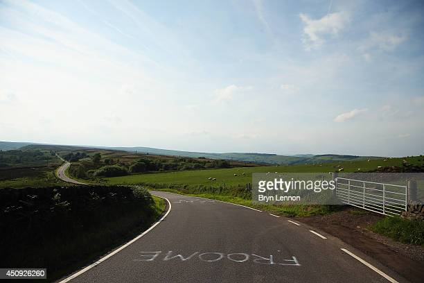 2013 race winner Chris Froome's name is seen painted on the road of stage two as Yorkshire prepares to host the Grand Depart on June 20 2014 in...