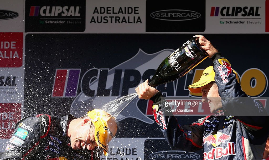 Race winner <a gi-track='captionPersonalityLinkClicked' href=/galleries/search?phrase=Craig+Lowndes&family=editorial&specificpeople=213462 ng-click='$event.stopPropagation()'>Craig Lowndes</a> driver of the #888 Red Bull Racing Australia Holden, is sprayed with champagne by team mate Jamie Whincup who finished third after race one of the Clipsal 500, which is round one of the V8 Supercar Championship Series, at the Adelaide Street Circuit on March 2, 2013 in Adelaide, Australia.
