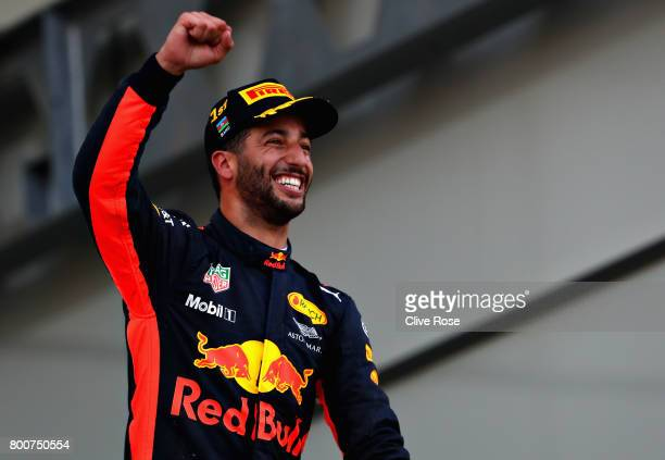Race winner Daniel Ricciardo of Australia and Red Bull Racing celebrates his win on the podium during the Azerbaijan Formula One Grand Prix at Baku...