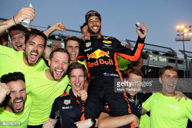 Race winner Daniel Ricciardo of Australia and Red Bull Racing celebrates his win with his team during the Azerbaijan Formula One Grand Prix at Baku...