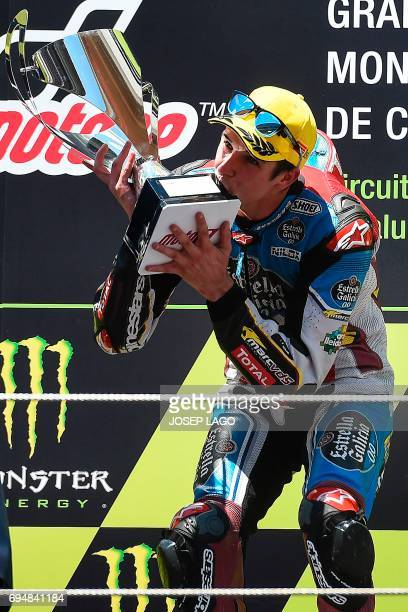 Race winner EG 00 Marc VDS Spanish rider Alex Marquez celebrates on the podium with the trophy of the Moto2 race of the Catalunya Grand Prix at the...