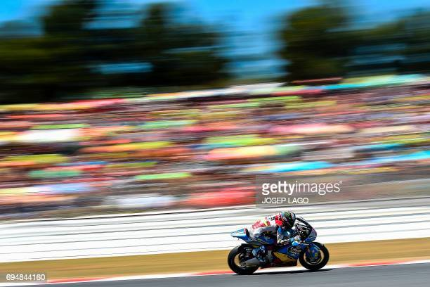 Race winner EG 00 Marc VDS Spanish rider Alex Marquez competes in the Moto2 race of the Catalunya Grand Prix at the Montmelo racetrack near Barcelona...