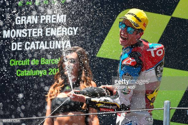Race winner EG 00 Marc VDS's Spanish rider Alex Marquez sprays cava on the podium after the Moto2 race of the Catalunya Grand Prix at the Montmelo...