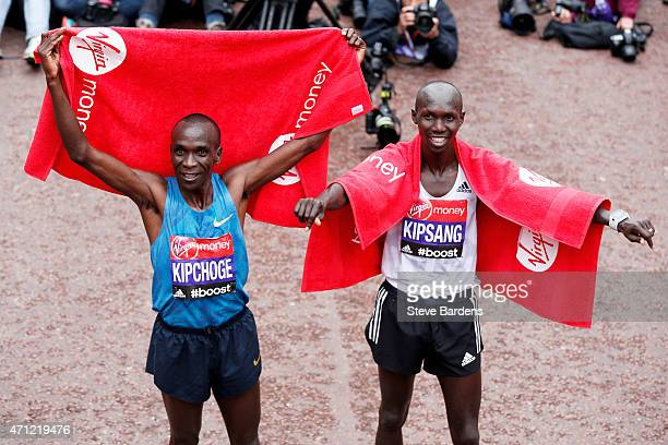 Race winner Eliud Kipchoge of Kenya and second placed Wilson Kipsang of Kenya celebrate following the Men's race during the Virgin Money London...