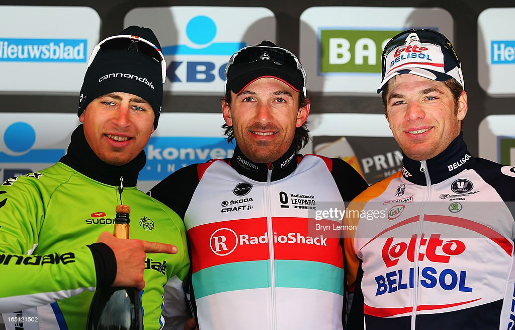 Race winner <a gi-track='captionPersonalityLinkClicked' href=/galleries/search?phrase=Fabian+Cancellara&family=editorial&specificpeople=573515 ng-click='$event.stopPropagation()'>Fabian Cancellara</a> of Switzerland and RadioShack Leopard standards on top of the podium with second placed <a gi-track='captionPersonalityLinkClicked' href=/galleries/search?phrase=Peter+Sagan&family=editorial&specificpeople=4846179 ng-click='$event.stopPropagation()'>Peter Sagan</a> (l) of Slovakia and Cannondale and third placed Jurgen Roelandts of Belgium and Lotto Belisol during the 97th Tour of Flanders from Brugge to Oudenaarde on March 31, 2013 in Oudenaarde, Belgium.