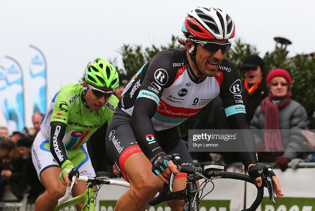 Race winner <a gi-track='captionPersonalityLinkClicked' href=/galleries/search?phrase=Fabian+Cancellara&family=editorial&specificpeople=573515 ng-click='$event.stopPropagation()'>Fabian Cancellara</a> of Switzerland and RadioShack Leopard leads second placed <a gi-track='captionPersonalityLinkClicked' href=/galleries/search?phrase=Peter+Sagan&family=editorial&specificpeople=4846179 ng-click='$event.stopPropagation()'>Peter Sagan</a> (l) of Slovakia and Cannondale during the 97th Tour of Flanders from Brugge to Oudenaarde on March 31, 2013 in Oudenaarde, Belgium.
