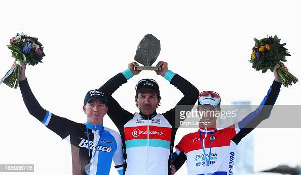 Race winner Fabian Cancellara of Switzerland and Radioshack Leopard celebrates on the podium with second placed Sep Vanmarcke of Belgium and Blanco...
