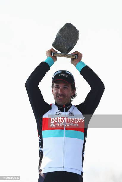 Race winner Fabian Cancellara of Switzerland and Radioshack Leopard celebrates on the podium following the 2013 Paris Roubaix cycle race from...
