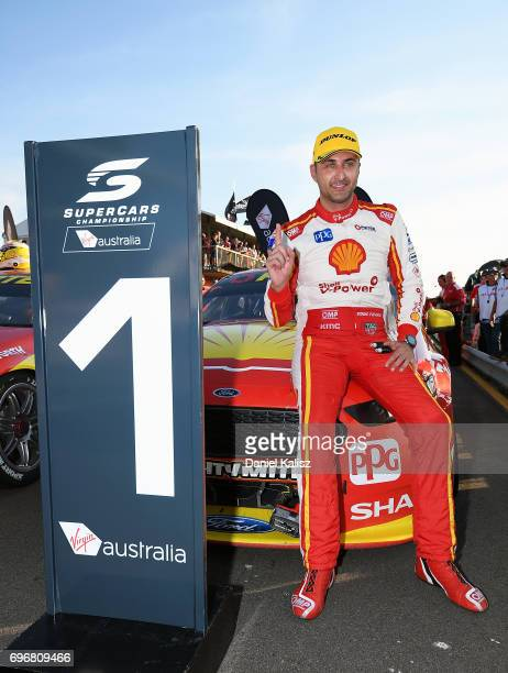 Race winner Fabian Coulthard driver of the Shell VPower Racing Team Ford Falcon FGX celebrates after race 11 for the Darwin Triple Crown which is...
