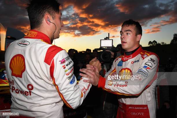 Race winner Fabian Coulthard driver of the Shell VPower Racing Team Ford Falcon FGX is congratulated by his team mate Scott McLaughlin afte race 17...