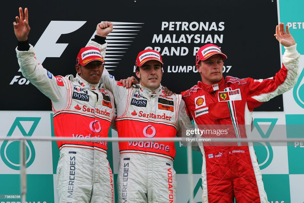 Race winner Fernando Alonso (C) of Spain and McLaren Mercedes celebrates with second placed team mate Lewis Hamilton (L) of Great Britain and McLaren Mercedes, and third placed Kimi Raikkonen (R) of Finland and Ferrari following the Malaysian Formula One Grand Prix at the Sepang Circuit on April 8, 2007, in Kuala Lumpur, Malaysia.