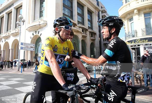 Race winner Geraint Thomas of Great Britain and Team Sky is congratulated by teammate Sergio Luis Henao of Colombia following stage 7 of the 2016...