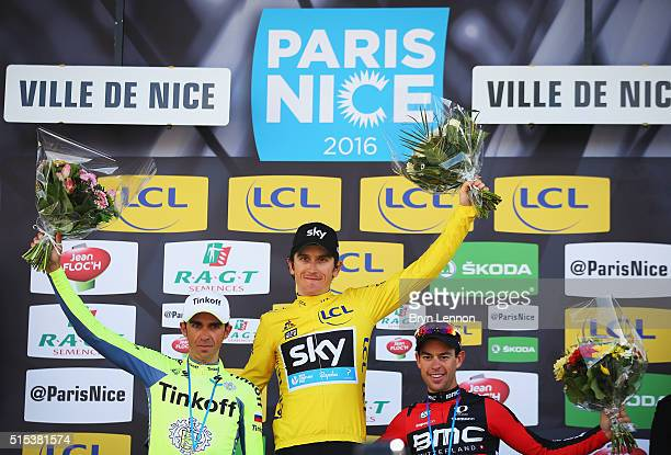 Race winner Geraint Thomas of Great Britain and Team Sky stands on the podium with Alberto Contador of Spain and Tinkoff and Richie Porte of the BMC...