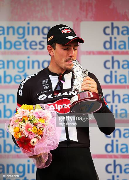 Race winner John Degenkolb of Germany and Team Giant Alpecin kisses the trophy following the 2015 MilanSanRemo cycle race on March 22 2015 in Milan...