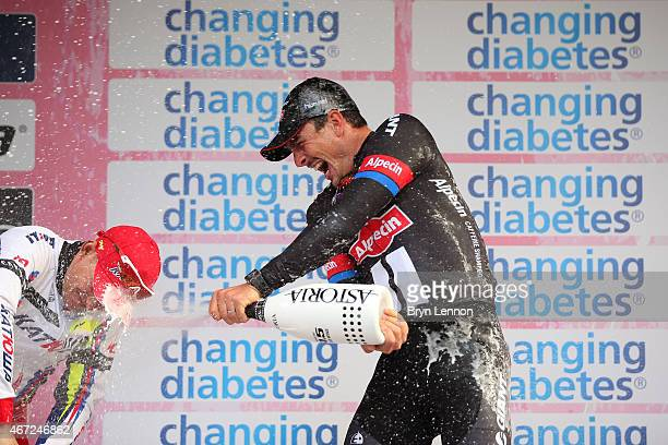 Race winner John Degenkolb of Germany and Team Giant Alpecin celebrates on the podium following the 2015 MilanSanRemo cycle race on March 22 2015 in...