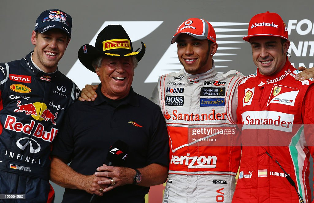 Race winner <a gi-track='captionPersonalityLinkClicked' href=/galleries/search?phrase=Lewis+Hamilton+-+Racecar+Driver&family=editorial&specificpeople=586983 ng-click='$event.stopPropagation()'>Lewis Hamilton</a> (2nd right) of Great Britain and McLaren appears on the podium with second placed <a gi-track='captionPersonalityLinkClicked' href=/galleries/search?phrase=Sebastian+Vettel&family=editorial&specificpeople=2233605 ng-click='$event.stopPropagation()'>Sebastian Vettel</a> (left) of Germany and Red Bull Racing, third placed Fernando Alonso (right) of Spain and Ferrari and former F1 World Champion <a gi-track='captionPersonalityLinkClicked' href=/galleries/search?phrase=Mario+Andretti&family=editorial&specificpeople=93739 ng-click='$event.stopPropagation()'>Mario Andretti</a> (2nd left) following the United States Formula One Grand Prix at the Circuit of the Americas on November 18, 2012 in Austin, Texas.