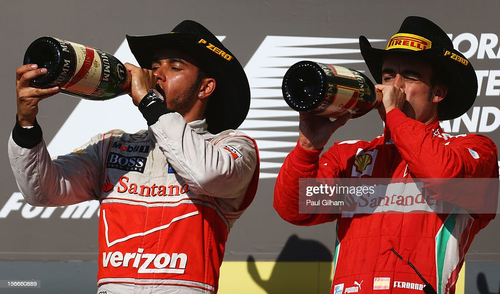 Race winner <a gi-track='captionPersonalityLinkClicked' href=/galleries/search?phrase=Lewis+Hamilton+-+Racecar+Driver&family=editorial&specificpeople=586983 ng-click='$event.stopPropagation()'>Lewis Hamilton</a> (L) of Great Britain and McLaren celebrates on the podium with third placed Fernando Alonso (R) of Spain and Ferrari following the United States Formula One Grand Prix at the Circuit of the Americas on November 18, 2012 in Austin, Texas.