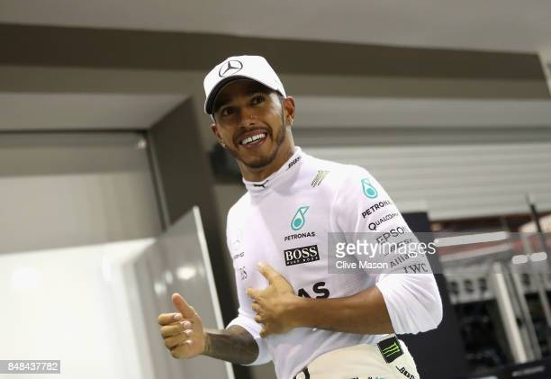 Race winner Lewis Hamilton of Great Britain and Mercedes GP celebrates after the Formula One Grand Prix of Singapore at Marina Bay Street Circuit on...