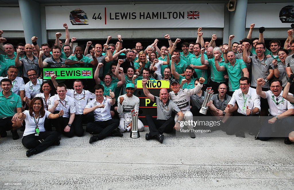 Race winner Lewis Hamilton of Great Britain and Mercedes GP and second placed Nico Rosberg of Germany and Mercedes GP celebrate with team mates and mechanics in the pitlane after the Malaysia Formula One Grand Prix at the Sepang Circuit on March 30, 2014 in Kuala Lumpur, Malaysia.