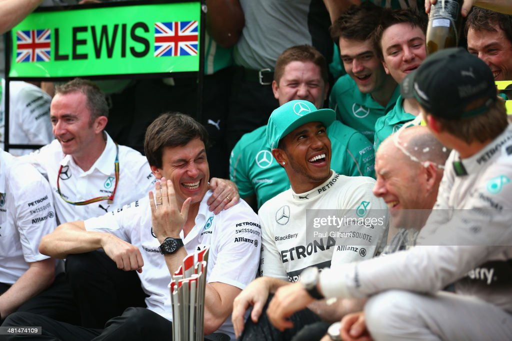 Race winner Lewis Hamilton of Great Britain and Mercedes GP and second placed Nico Rosberg of Germany and Mercedes GP celebrate with Mercedes GP Executive Director Toto Wolff alongside team mates and mechanics in the pitlane after the Malaysia Formula One Grand Prix at the Sepang Circuit on March 30, 2014 in Kuala Lumpur, Malaysia.