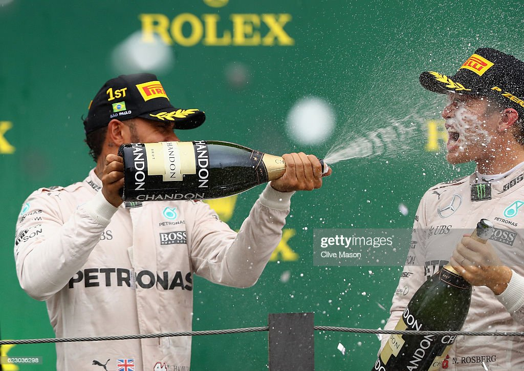 Race winner Lewis Hamilton of Great Britain and Mercedes GP and second placed finisher Nico Rosberg of Germany and Mercedes GP celebrate on the podium during the Formula One Grand Prix of Brazil at Autodromo Jose Carlos Pace on November 13, 2016 in Sao Paulo, Brazil.