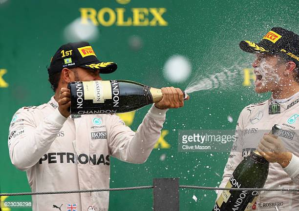 Race winner Lewis Hamilton of Great Britain and Mercedes GP and second placed finisher Nico Rosberg of Germany and Mercedes GP celebrate on the...