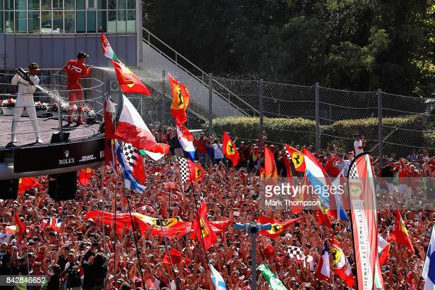 Race winner Lewis Hamilton of Great Britain and Mercedes GP and third place Sebastian Vettel of Germany and Ferrari celebrate on the podium after the...