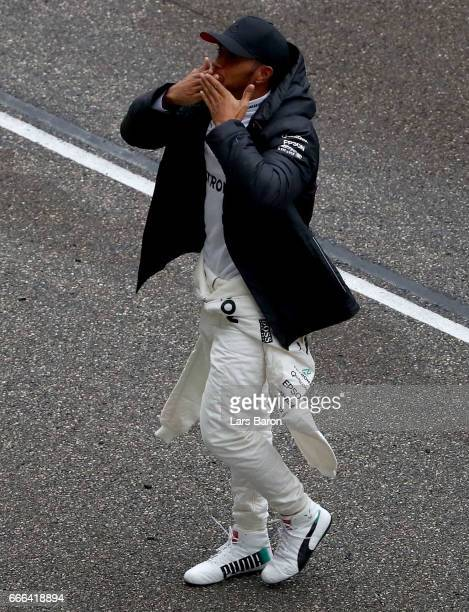 Race winner Lewis Hamilton of Great Britain and Mercedes GP blows kisses to the crowd during the Formula One Grand Prix of China at Shanghai...