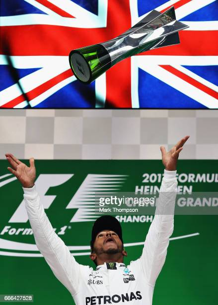 Race winner Lewis Hamilton of Great Britain and Mercedes GP celebrates his win on the podium during the Formula One Grand Prix of China at Shanghai...