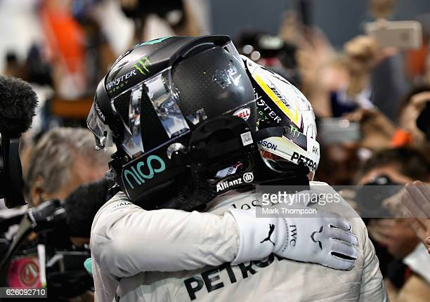 Race winner Lewis Hamilton of Great Britain and Mercedes GP hugs second placed finisher Nico Rosberg of Germany and Mercedes GP in parc ferme during...