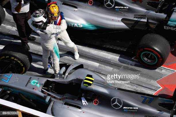Race winner Lewis Hamilton of Great Britain and Mercedes GP hugs second place finisher Valtteri Bottas of Finland and Mercedes GP in parc ferme...