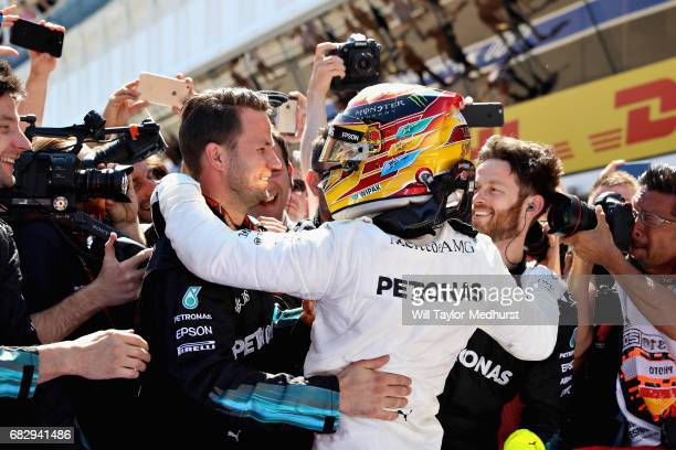 Race winner Lewis Hamilton of Great Britain and Mercedes GP celebrates in parc ferme during the Spanish Formula One Grand Prix at Circuit de...