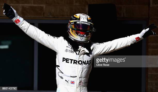 Race winner Lewis Hamilton of Great Britain and Mercedes GP celebrates in parc ferme during the United States Formula One Grand Prix at Circuit of...