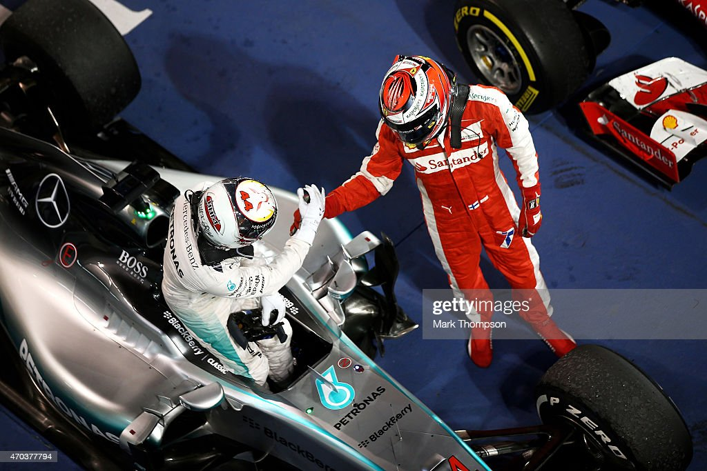 Race winner <a gi-track='captionPersonalityLinkClicked' href=/galleries/search?phrase=Lewis+Hamilton&family=editorial&specificpeople=586983 ng-click='$event.stopPropagation()'>Lewis Hamilton</a> of Great Britain and Mercedes GP is congratulated by <a gi-track='captionPersonalityLinkClicked' href=/galleries/search?phrase=Kimi+Raikkonen&family=editorial&specificpeople=201904 ng-click='$event.stopPropagation()'>Kimi Raikkonen</a> of Finland and Ferrari in Parc Ferme following the Bahrain Formula One Grand Prix at Bahrain International Circuit on April 19, 2015 in Bahrain, Bahrain.