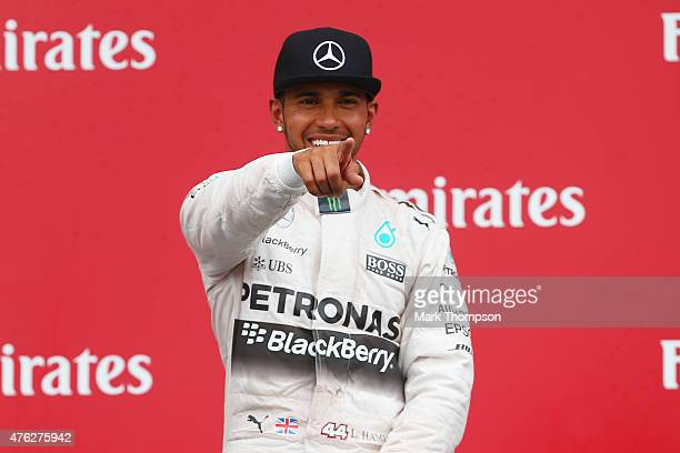 Race winner Lewis Hamilton of Great Britain and Mercedes GP celebrates on the podium during the Canadian Formula One Grand Prix at Circuit Gilles...