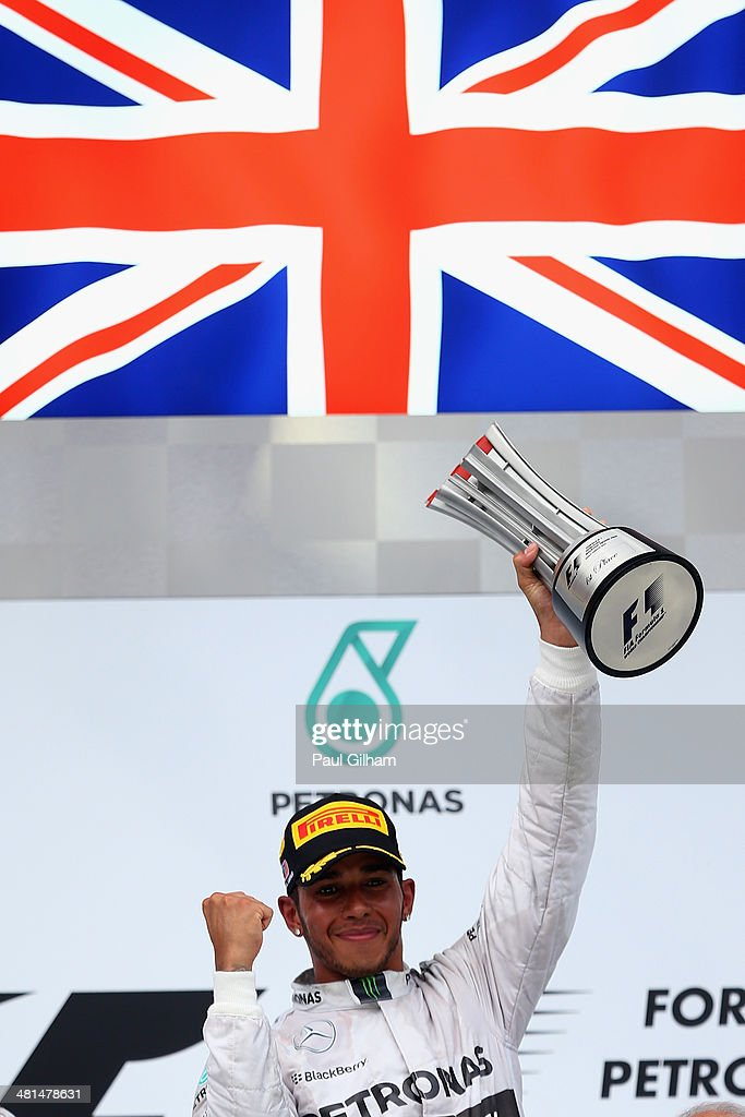 Race winner Lewis Hamilton of Great Britain and Mercedes GP celebrates on the podium after the Malaysia Formula One Grand Prix at the Sepang Circuit on March 30, 2014 in Kuala Lumpur, Malaysia.