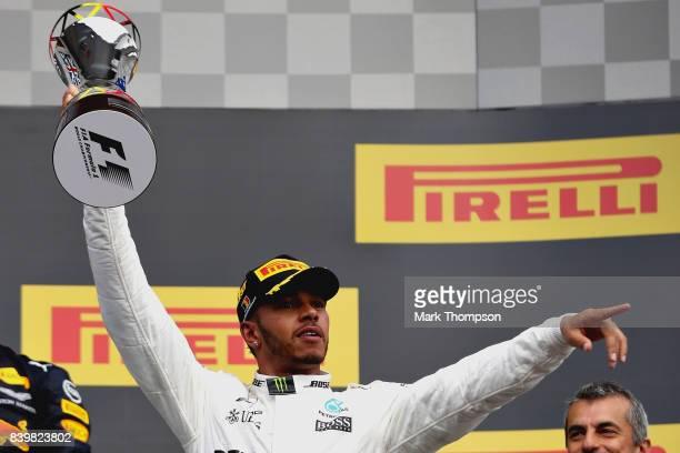 Race winner Lewis Hamilton of Great Britain and Mercedes GP celebrates on the podium during the Formula One Grand Prix of Belgium at Circuit de...