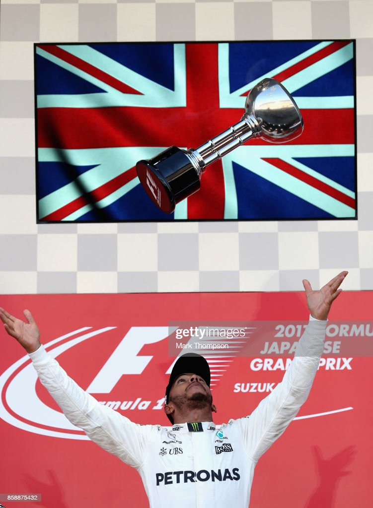 Race winner Lewis Hamilton of Great Britain and Mercedes GP celebrates on the podium during the Formula One Grand Prix of Japan at Suzuka Circuit on October 8, 2017 in Suzuka.