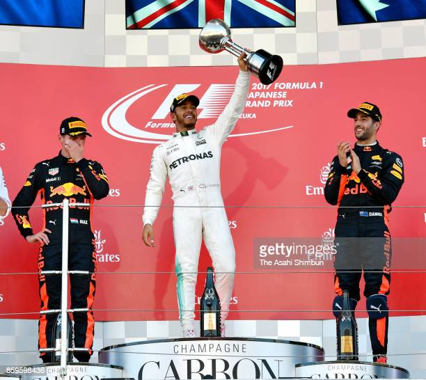 Race winner Lewis Hamilton of Great Britain and Mercedes GP celebrates on the podium with Max Verstappen of the Netherlands and Red Bull Racing and...