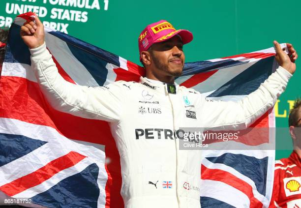 Race winner Lewis Hamilton of Great Britain and Mercedes GP celebrates on the podium during the United States Formula One Grand Prix at Circuit of...