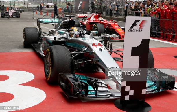Race winner Lewis Hamilton of Great Britain and Mercedes GP pulls into parc ferme during the Formula One Grand Prix of China at Shanghai...
