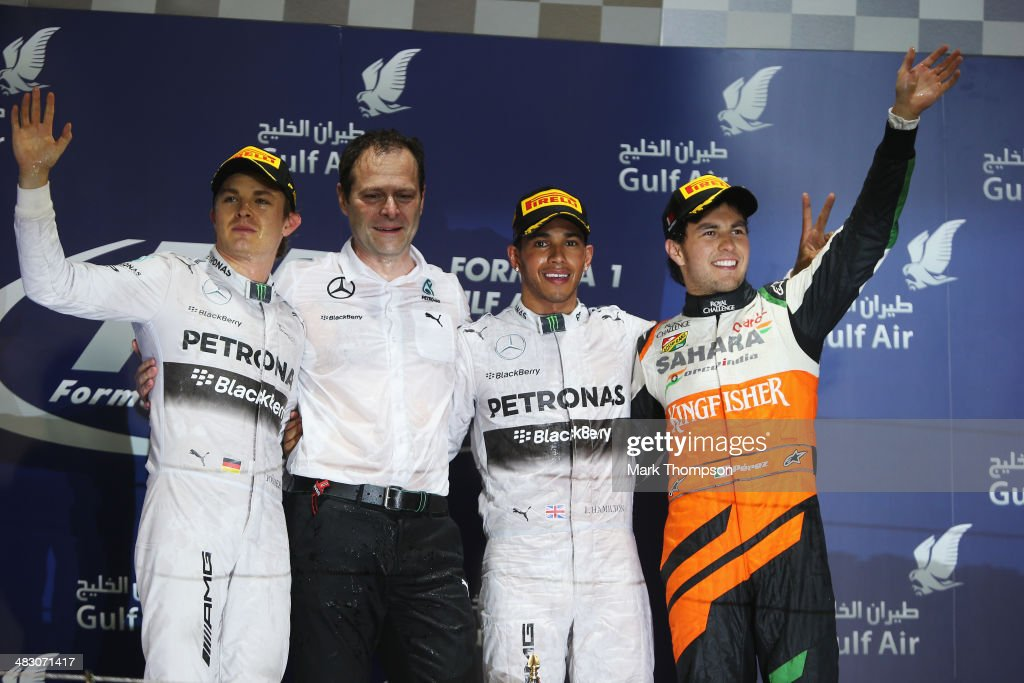 Race winner <a gi-track='captionPersonalityLinkClicked' href=/galleries/search?phrase=Lewis+Hamilton&family=editorial&specificpeople=586983 ng-click='$event.stopPropagation()'>Lewis Hamilton</a> (2nd right) of Great Britain and Mercedes GP, second placed <a gi-track='captionPersonalityLinkClicked' href=/galleries/search?phrase=Nico+Rosberg&family=editorial&specificpeople=800808 ng-click='$event.stopPropagation()'>Nico Rosberg</a> (left) of Germany and Mercedes GP, third placed Sergio Perez (right) of Mexico and Force India and Mercedes GP Engineering Director Aldo Costa (2nd left) celebrate on the podium following the Bahrain Formula One Grand Prix at the Bahrain International Circuit on April 6, 2014 in Sakhir, Bahrain.