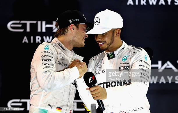 Race winner Lewis Hamilton of Great Britain and Mercedes GP congratulates second place finisher and World Drivers Champion Nico Rosberg of Germany...