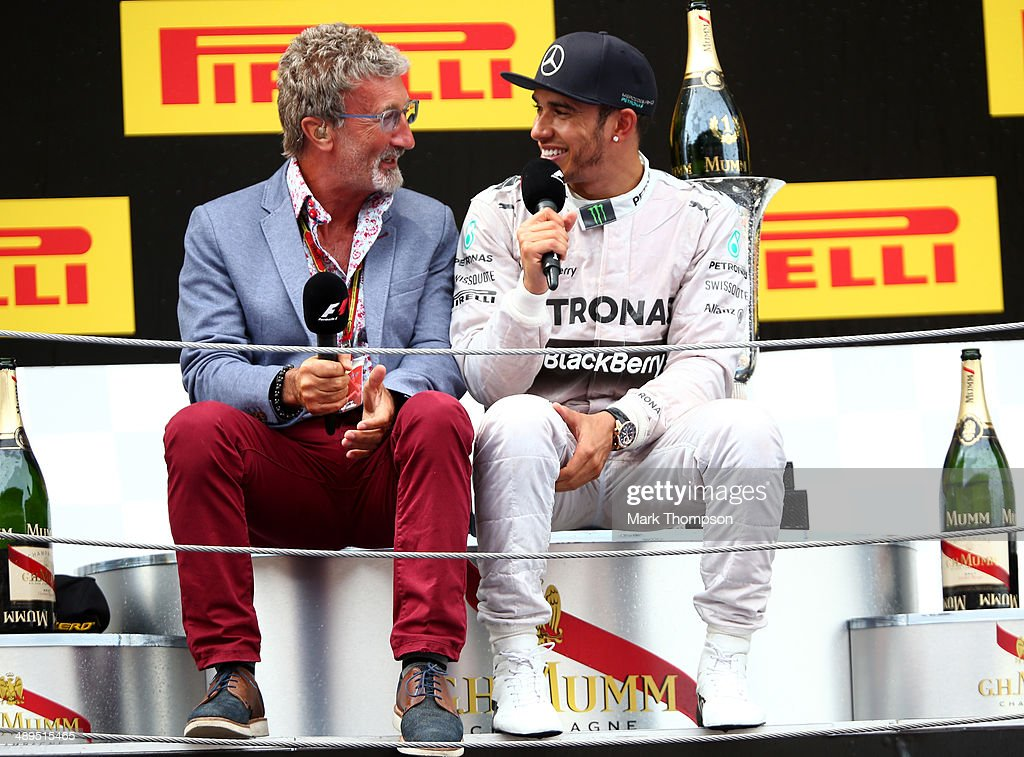 Race winner Lewis Hamilton of Great Britain and Mercedes GP speaks to Eddie Jordan on the podium after the Spanish Formula One Grand Prix at Circuit...