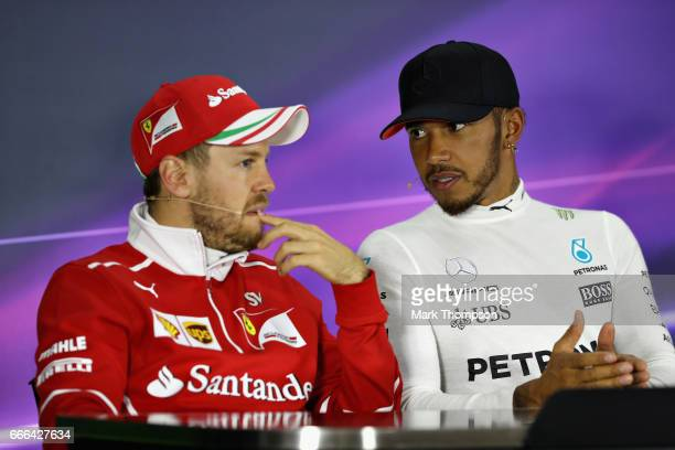 Race winner Lewis Hamilton of Great Britain and Mercedes GP talks with second placed finisher Sebastian Vettel of Germany and Ferrari in the post...